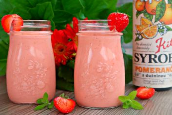 Healthy strawberry-carrot smoothie with orange